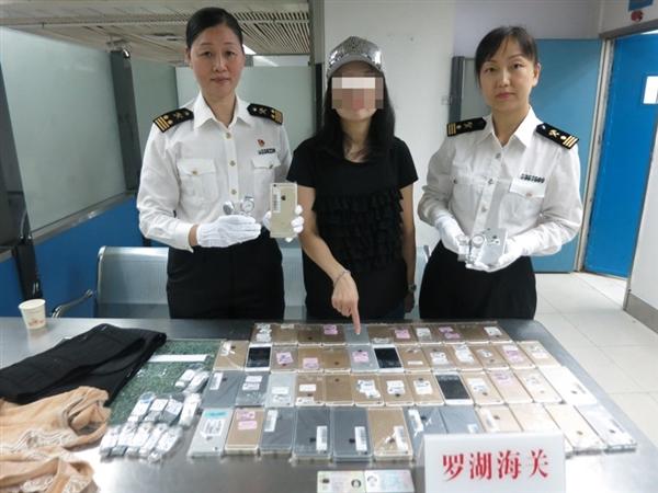 深圳截获史上最强走私女:浑身捆绑102部iPhone