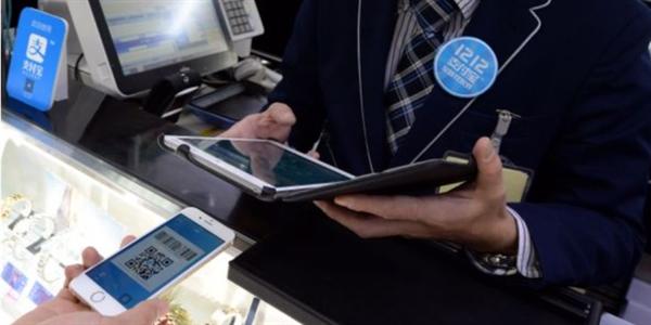 大陆游客狂爱手机支付:境外商家集体跪了